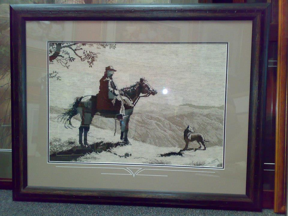 cross stitched grayscale man dog and horse